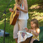 Myself playing guitar for children